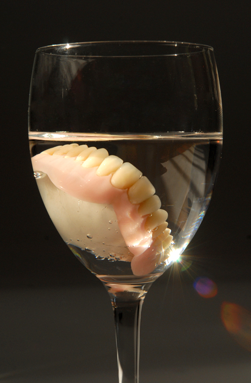 Grandfather Nap. Dentures In A Glass